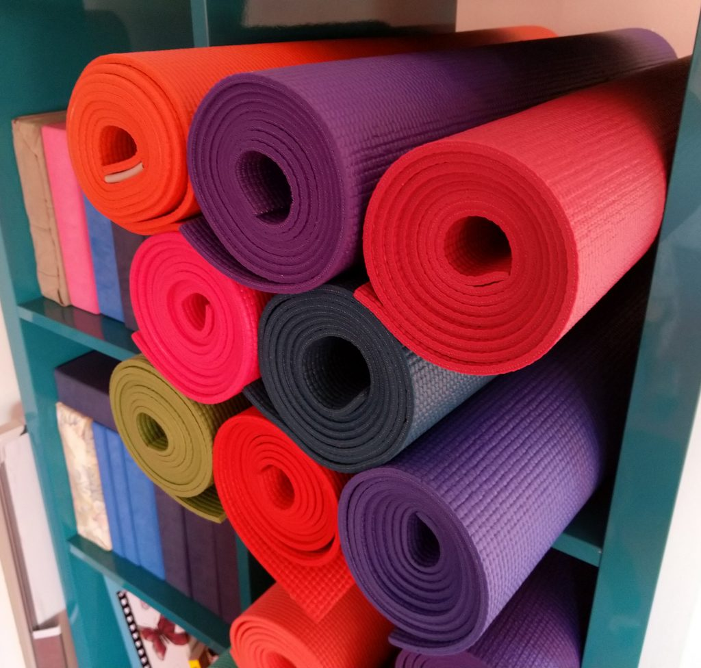 Rolled up yoga mats in the studio